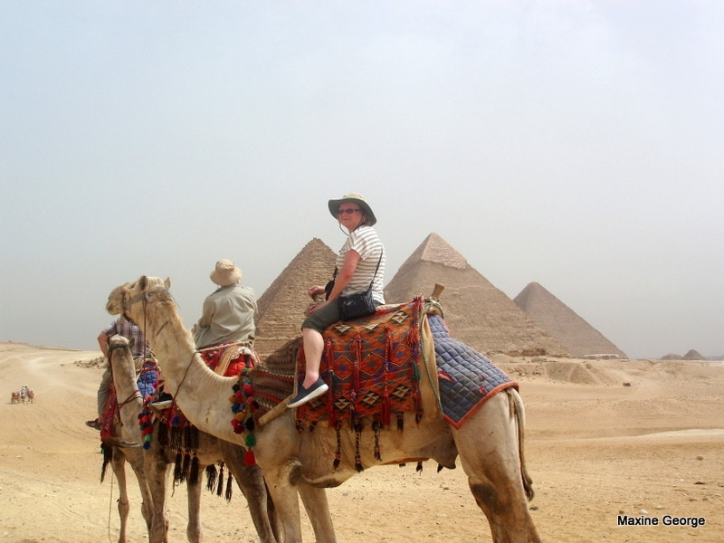 Marion rides a camel for the first time. Good show, girl! Great Pyramids Egypt Cairo