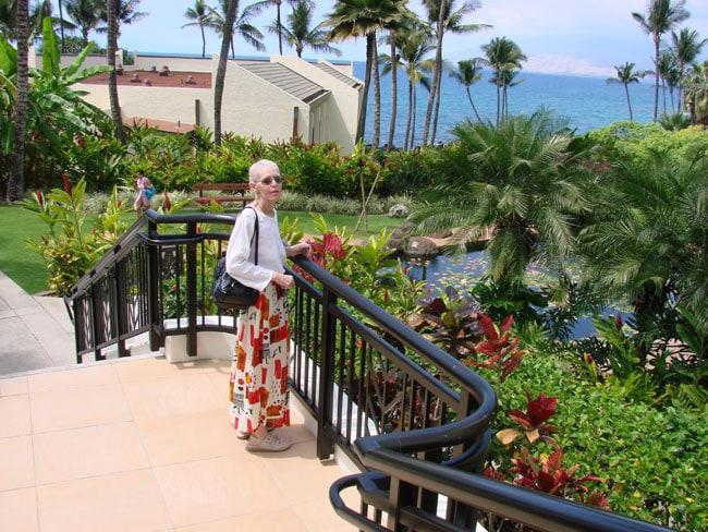 Cathy McDonald on steps at Wailea Beach Resort, Maui. Photo by M. Maxine George