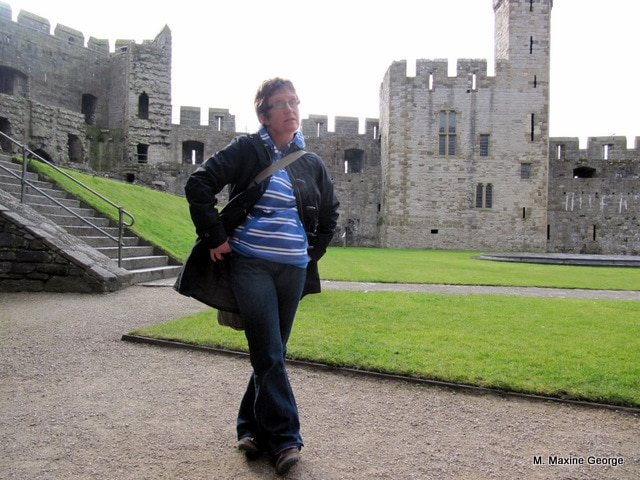 Donna Goodman surrounded by Caernarfon Castle. Rough walls indicate areas where additions were planned but never completed.