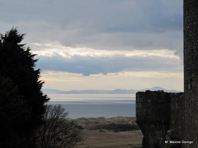 View of the valley, bay and mountains beyond Harlech Castle in March