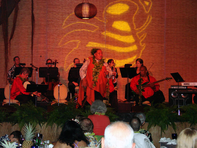 Guest star Uluwehi Guerrero performs for Luau guests at the Celebration of the Arts