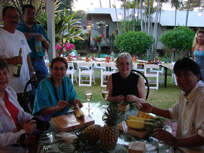 We practice pineapple cutting under Lance's supervision at Tutu's Place, Maui