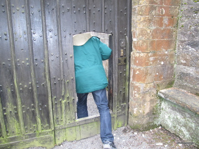 Stepping through the small door in the old gate at Gwydir Castle, Wales. Photo by M. Maxine George