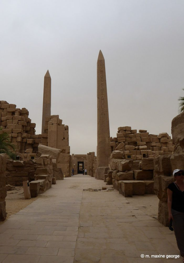Hatshepsut's partially concealed Obelisk with Tuthmose's Obelisk on right