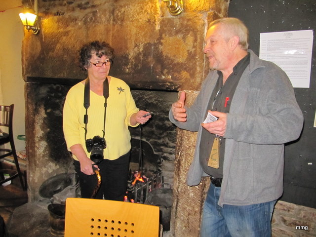Sandra Phinney listen attentively as Neil Bell tells about the history of the Queens Head Hotel, Monmouth, Wales