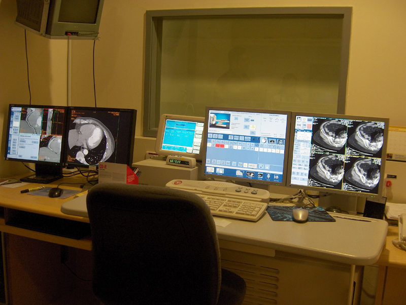 A panel of computer screens monitor a CT Scan