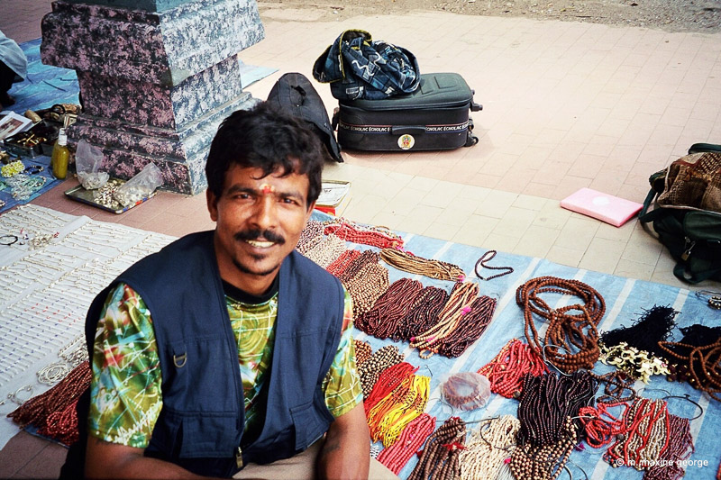 man with beads in Batu Cave