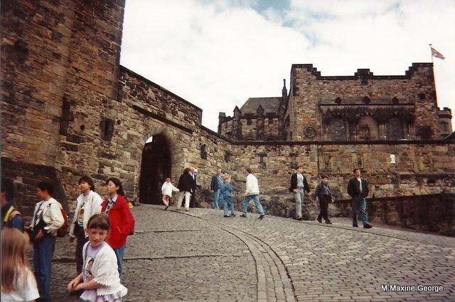 Cobblestones lead to Edinburgh Castle's stone gate house