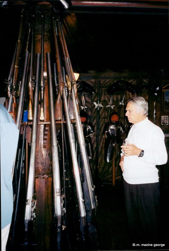 Bill McVean inspects long guns