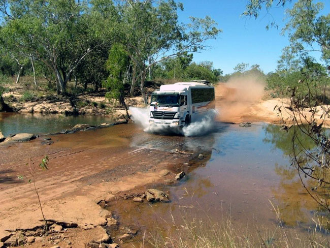 Our coach crossing the Gibb River. Photo courtesy of Heather and Barry Minton