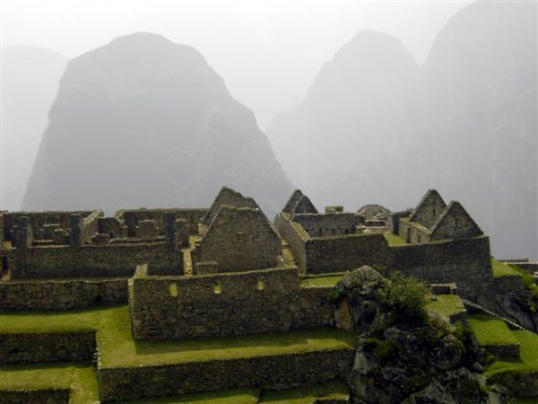 Another view of Machu Picchu amongst the mist in the mountains of Peru.